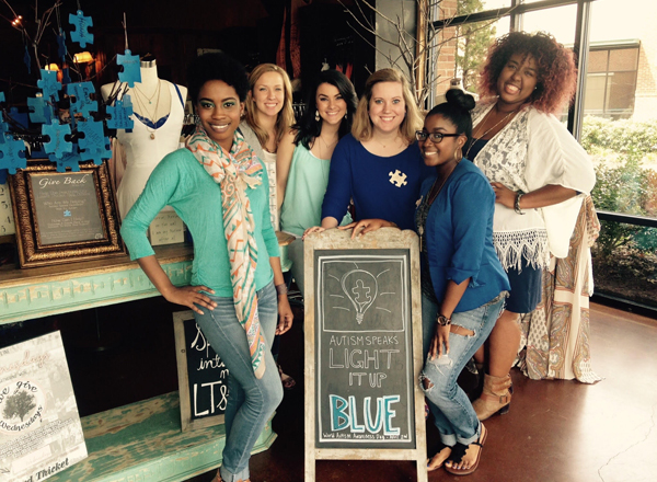A group of Lizard Thicket employees pose together inside the Peachtree City store for their Autism Speaks Fundraiser.