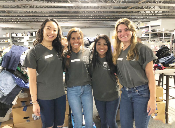 Image of 4 Lizard Thicket employees volunteering at The Norcross Co-Op.